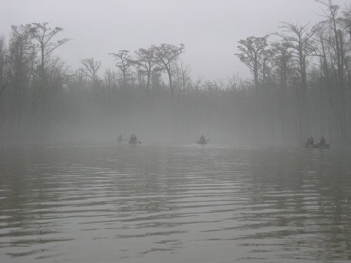 Members of the search team paddle Bayou DeView in winter of 2004.  [Photo by Lauren Morgens.]